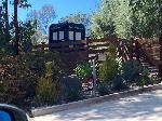 Our new neighbors put a TARDIS in their front yard.